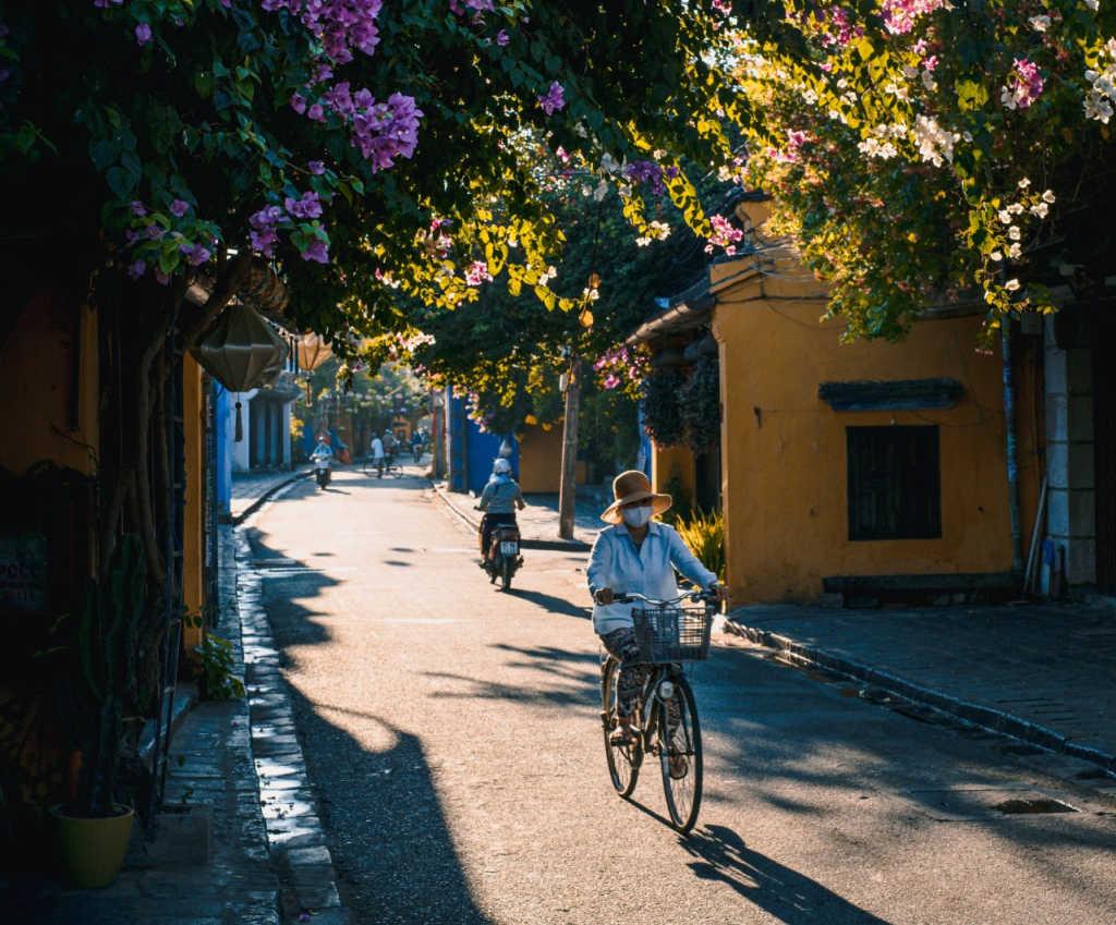 person biking down the street in Hoi An.