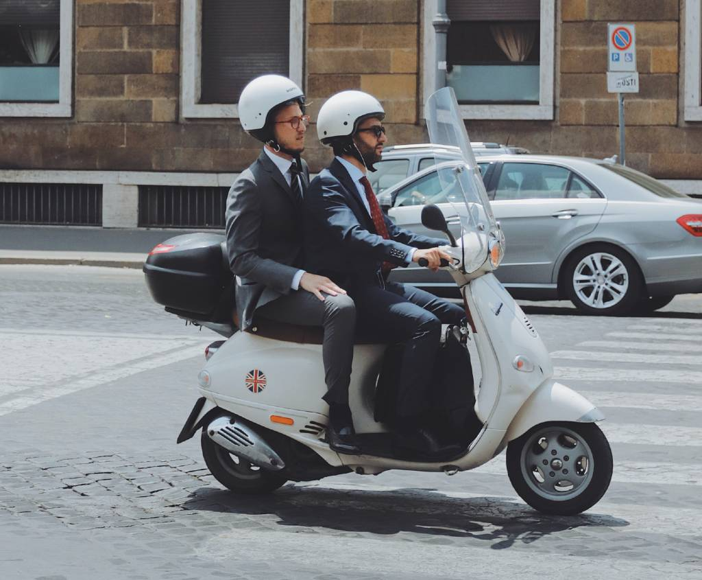two people on a Vespa in Rome.