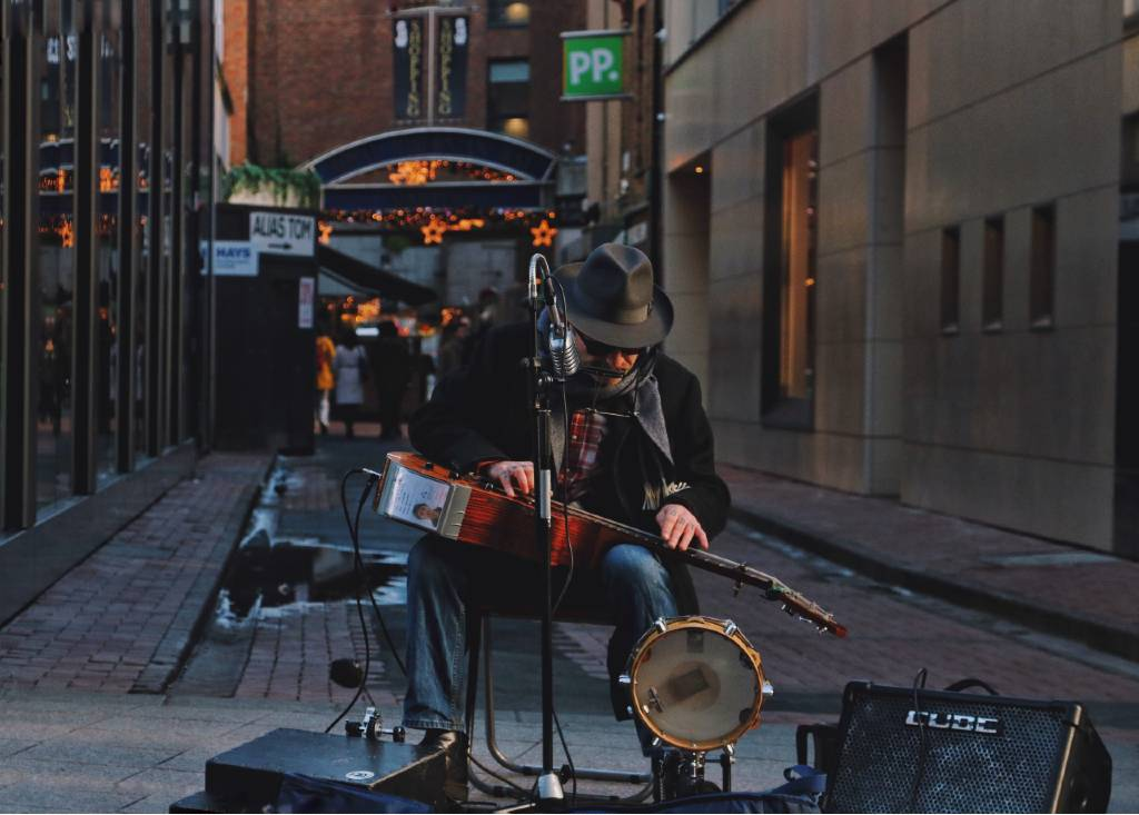 busker playing music on street in Dublin.