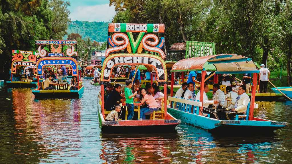 colorful boats on the Xochimilco canals in Mexico City.