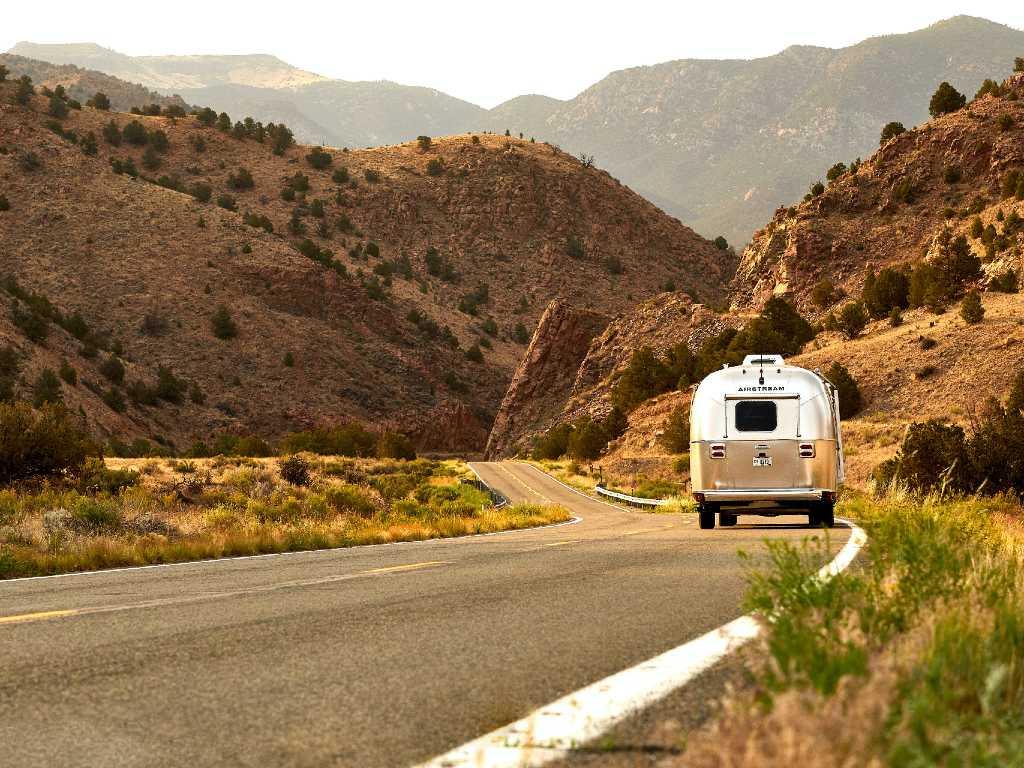 rv driving down a mountain road.
