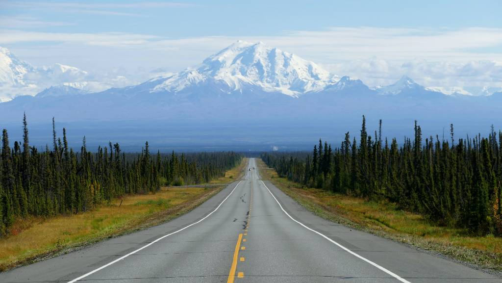 road with mountain in the distance in Alaska.