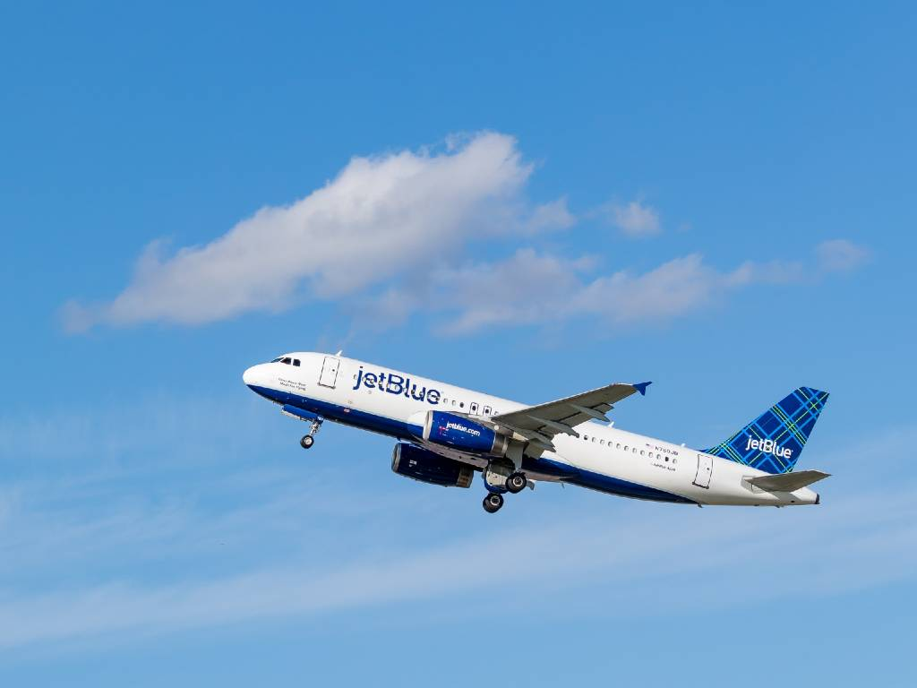 Jetblue plane flying overhead.
