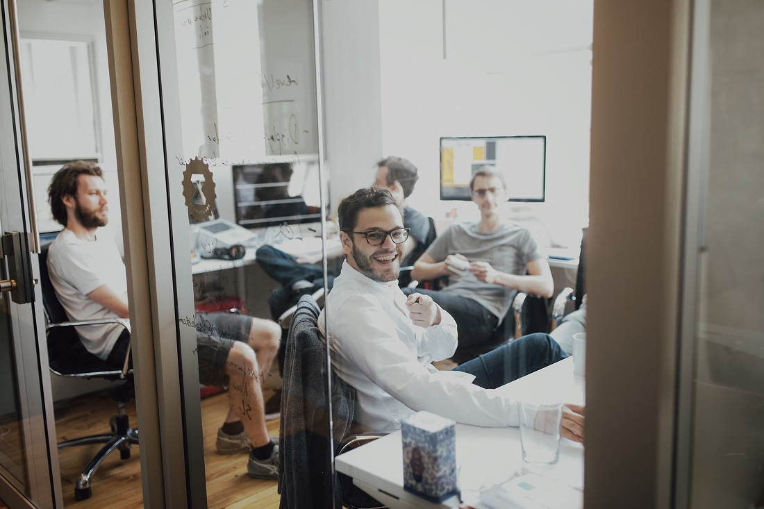 Group of Entrepreneurs Striving in Work Space