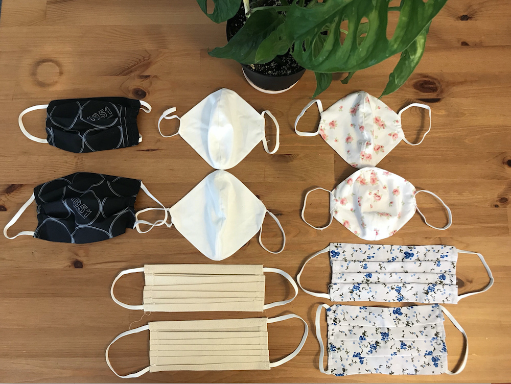 Five face mask designs, two of each. Different colors and patterns of fabric used for each pair of masks.