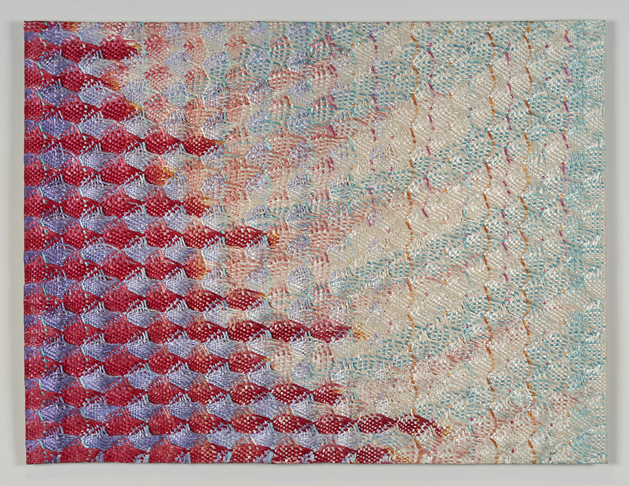 hand-painted weaving with pinks and blues at a gallery exhibition