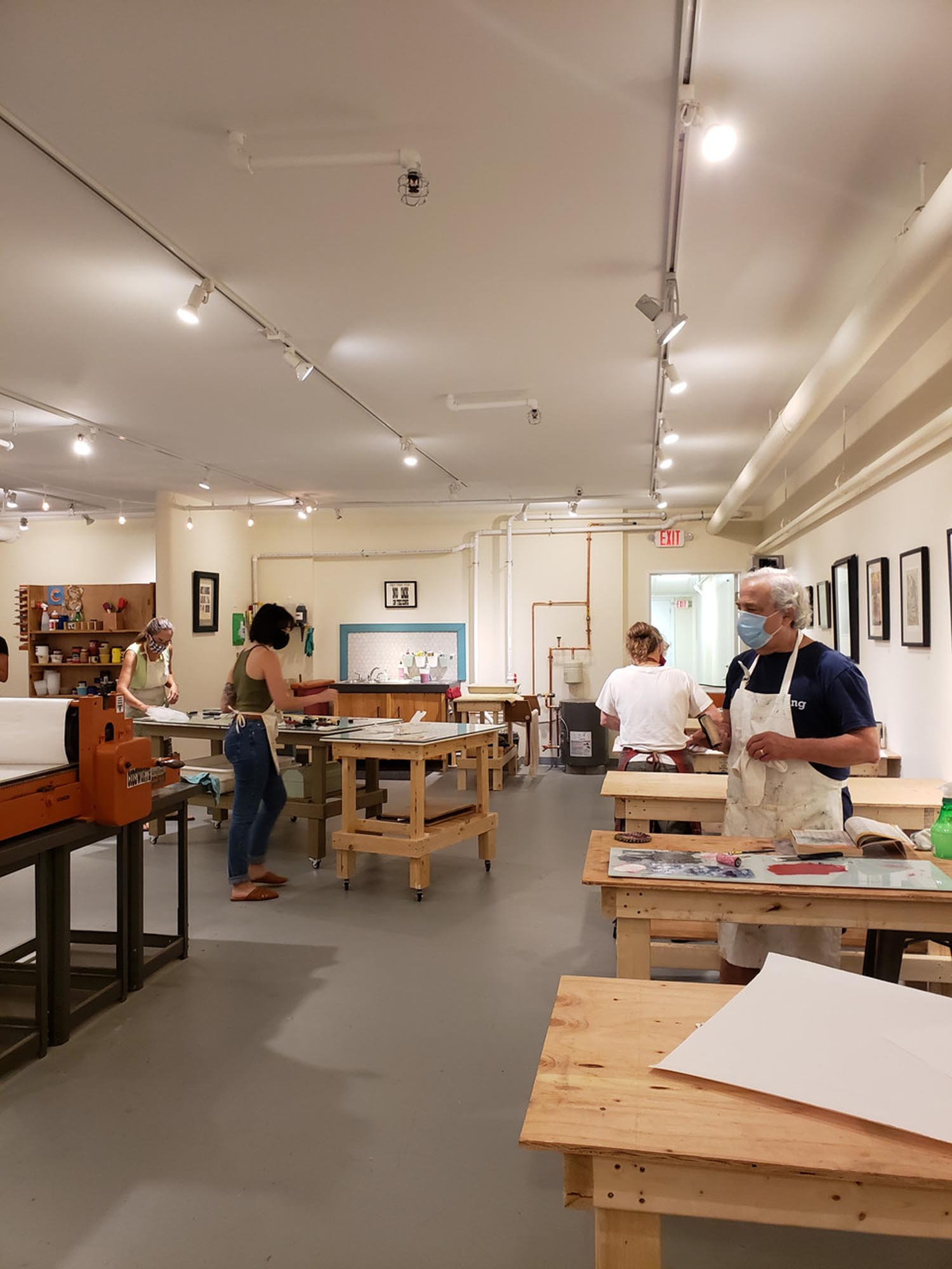 screen printing workshop, a studio with a few people spaced out at different tables