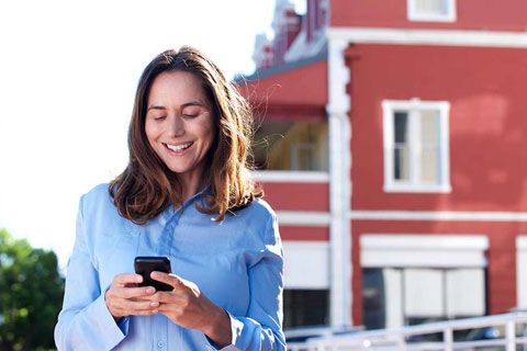 woman checking out the conveyancing steps on her phone