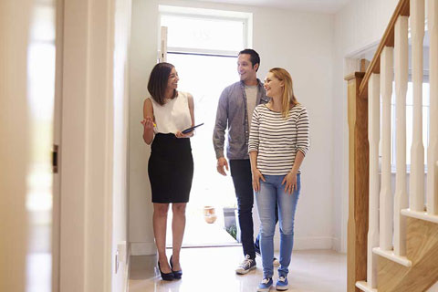 couple moving in having gone through the step by step conveyancing process