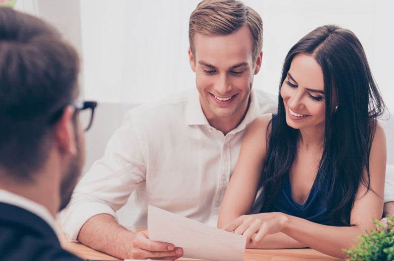 Couple asking a conveyancer 12 questions