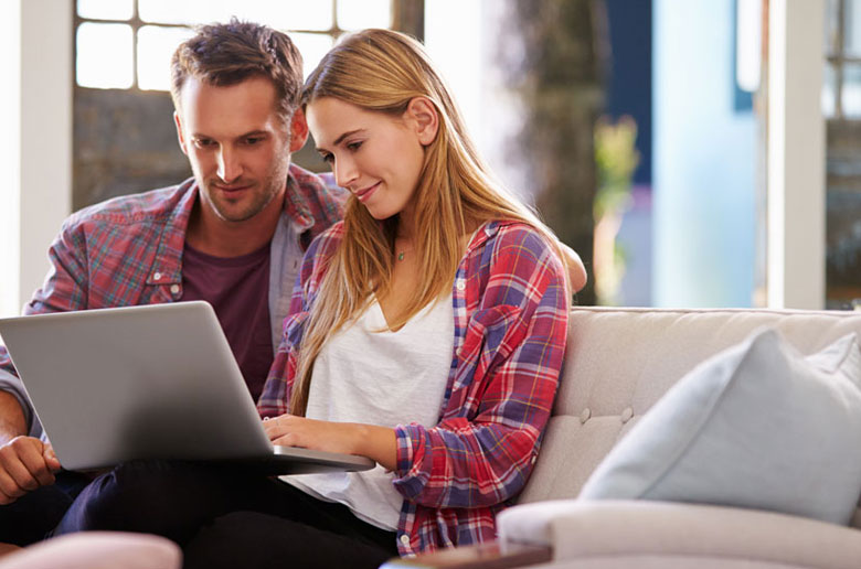 Family comparing online and local conveyancing