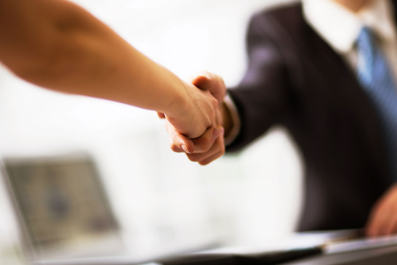 Shaking hands with a conveyancer after appraoching