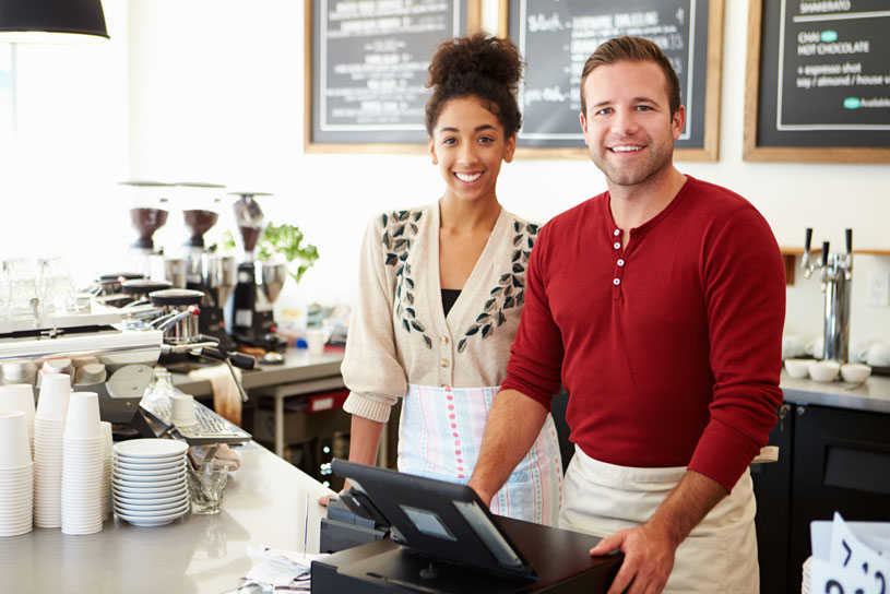 Young business owners happy having just signed a commercial lease