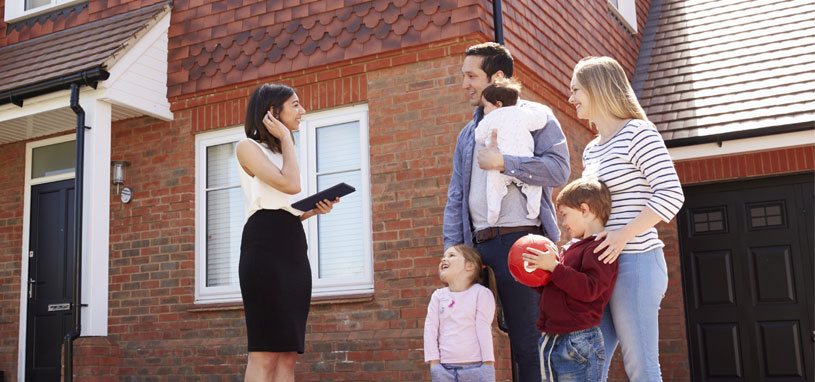 conveyancing lawyer meeting young family to discuss property transfer
