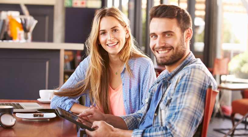 young couple signing online conveyancing documents