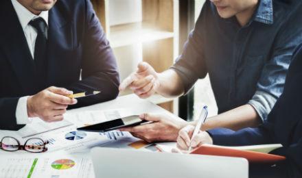 businessmen making financial modelling mistakes