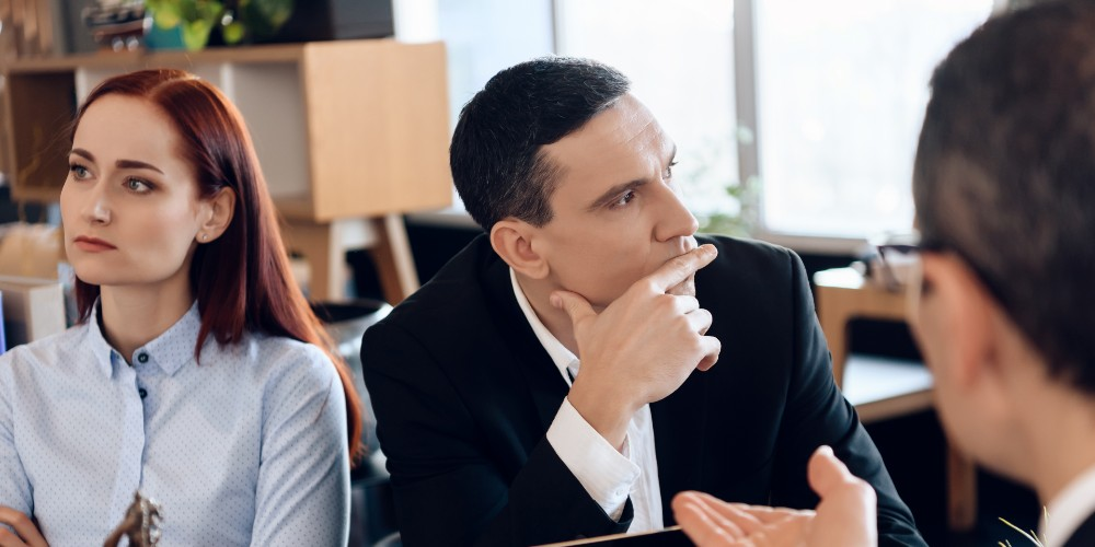 man and woman in discussion with business advisor