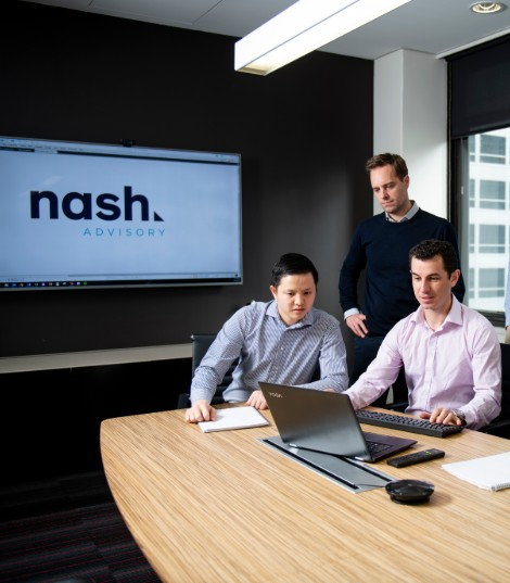 two nash advisory employees studying the businesses history
