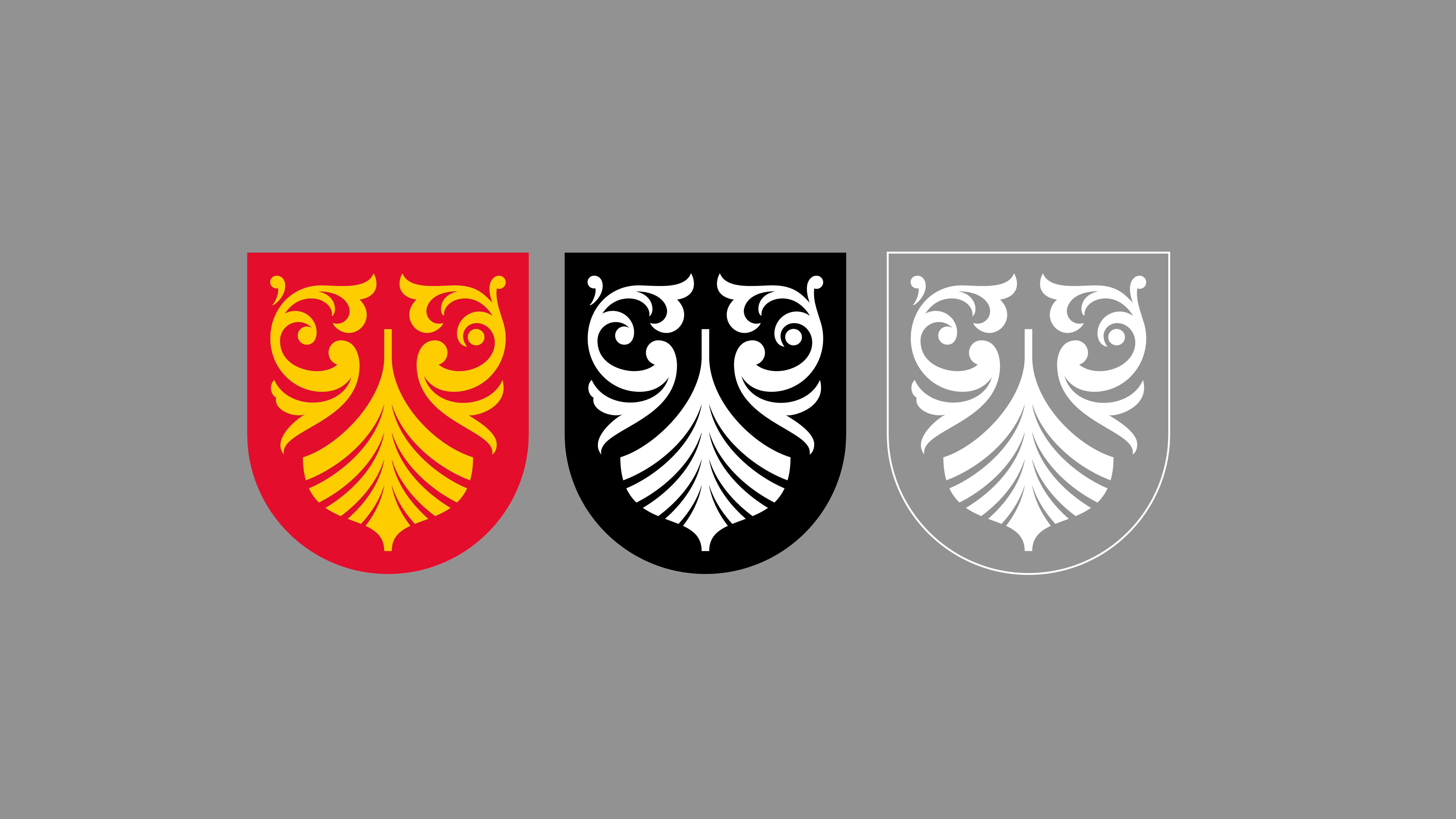 Fylkesvåpenet i ulike versjoner.
