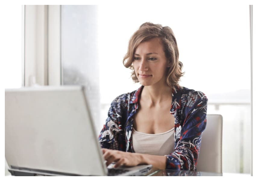 A woman sitting in front of her laptop