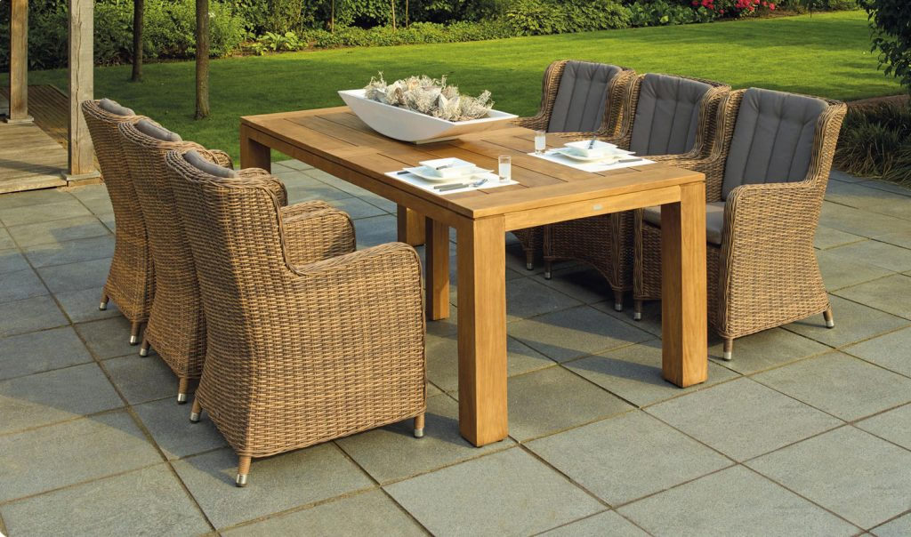 photo of outdoor patio furniture with six chairs and a table
