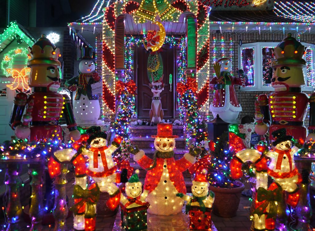 photo of a home with Christmas decorations including nutcrackers, snowmen, and twinkle lights