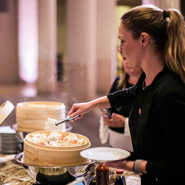 One of Cafe Natalie's senior event managers hand delivering the bride and groom's meal