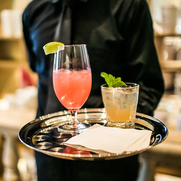 Experienced bartender during cocktail service