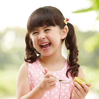 Invest in an industry with a bright future, Child eating golden kiwifruit