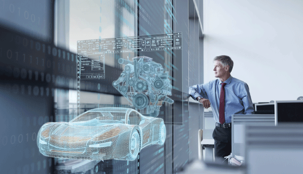 Man with CAD automotive graphic in front