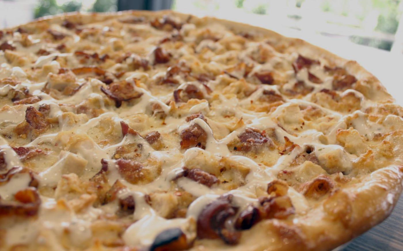 Signature chicken bacon ranch pizza.