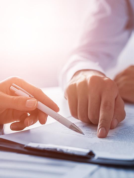 Hands doing paper work