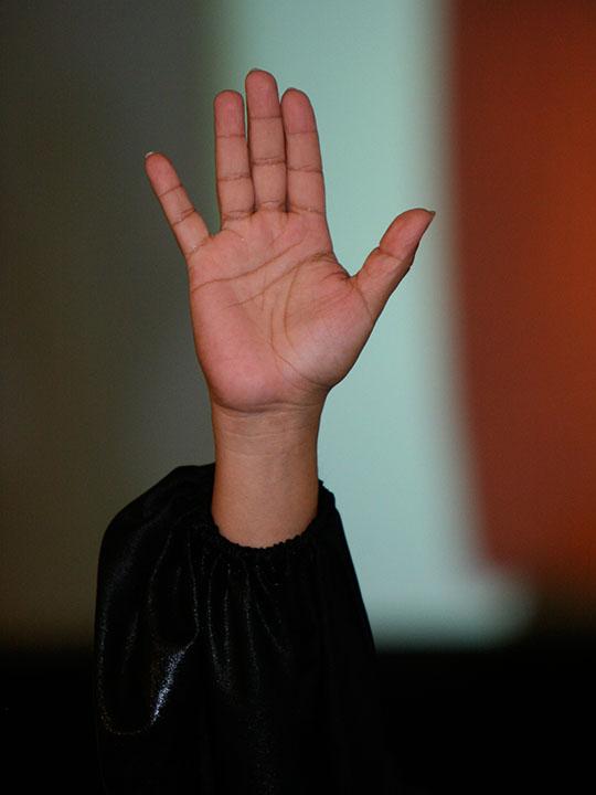 Hand raised to baptize