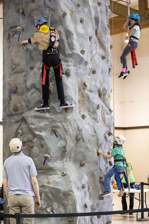 Pathfinders on rock climbing wall