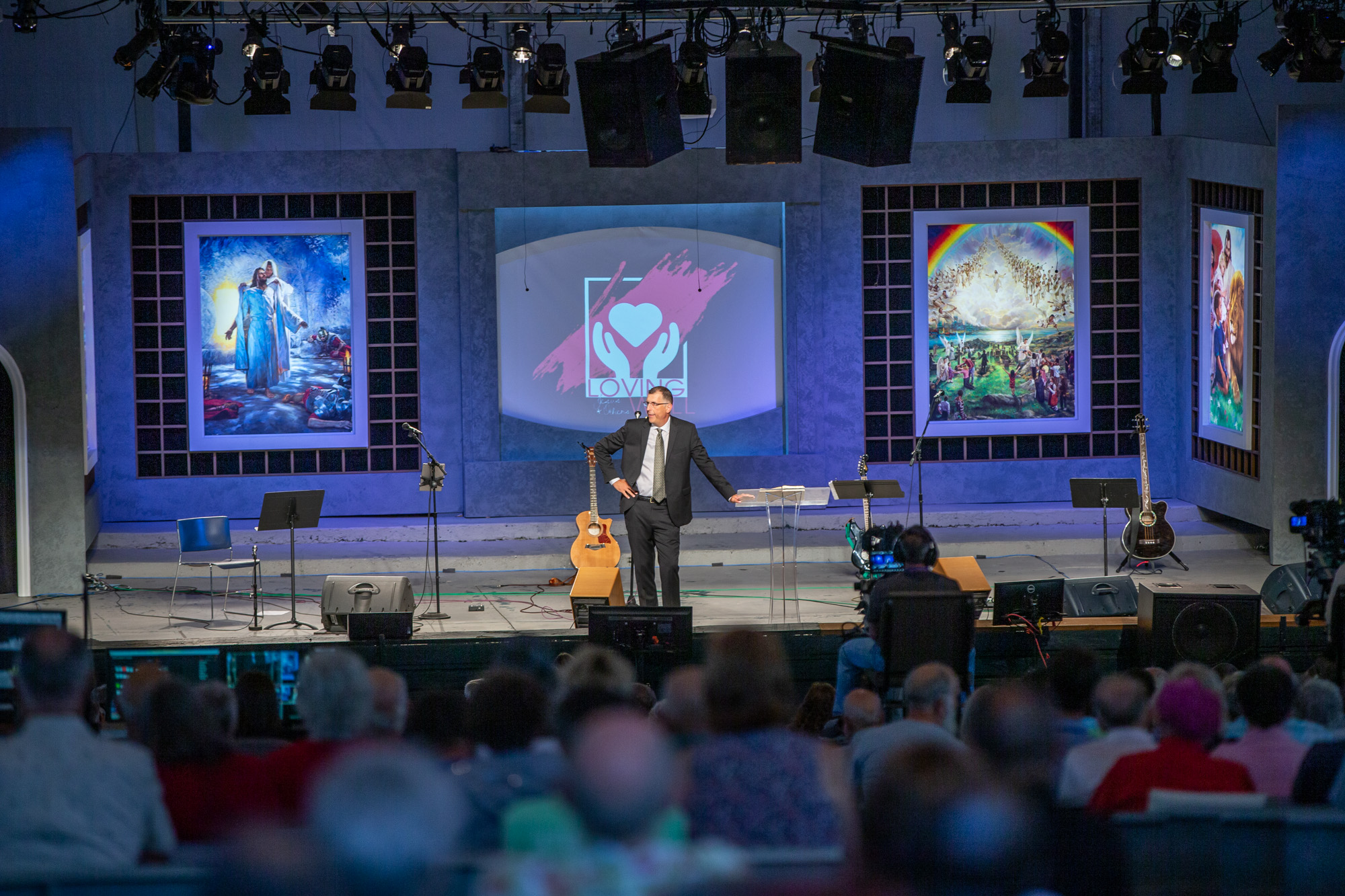 Preaching up front in big tent camp meeting
