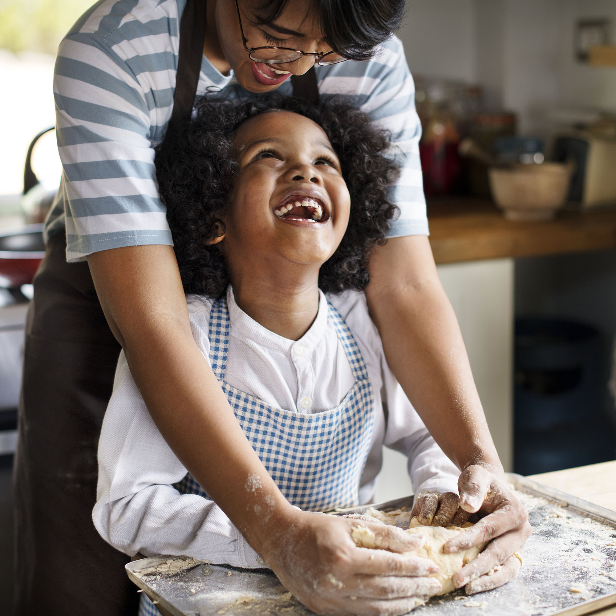 Mother and son baking bread