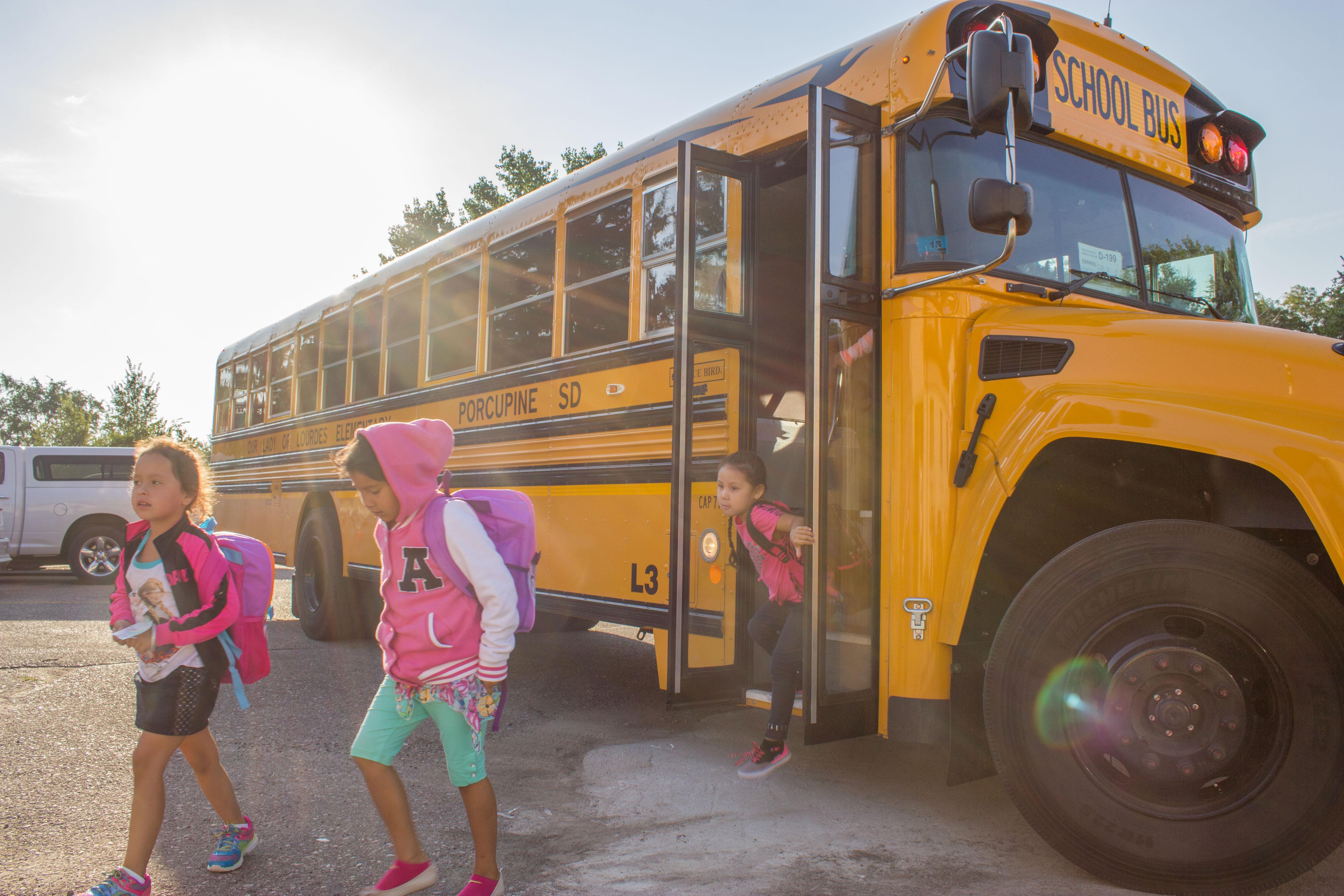 kids off school bus