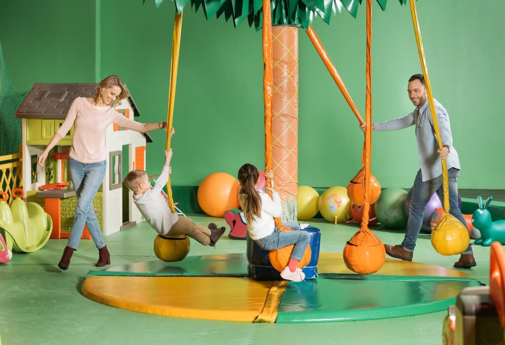 family at an indoor playground