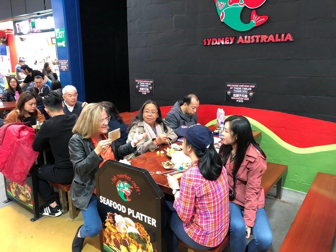 Mara Bun talks with Sydney Fish Market customers