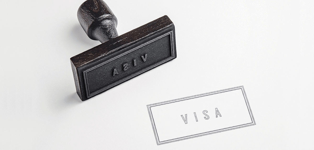 "Image of a stamp with words ""VISA"""