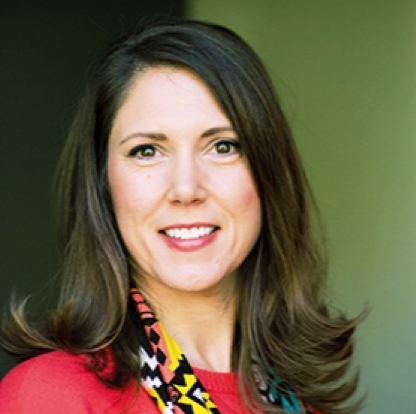 Headshot of Beth Franssen: she is a brunette and wearing a red shirt