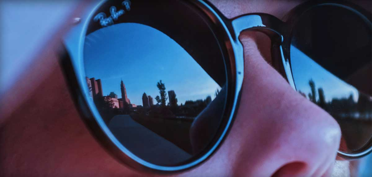 Columbus Ohio skyline reflected in a woman's sunglasses