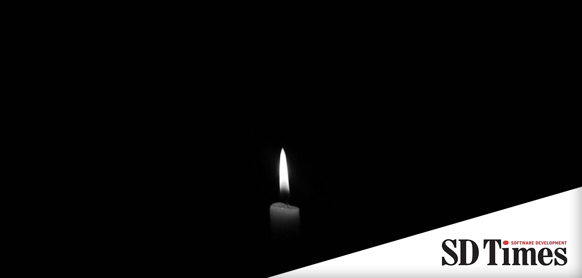 Dim candle on a black background