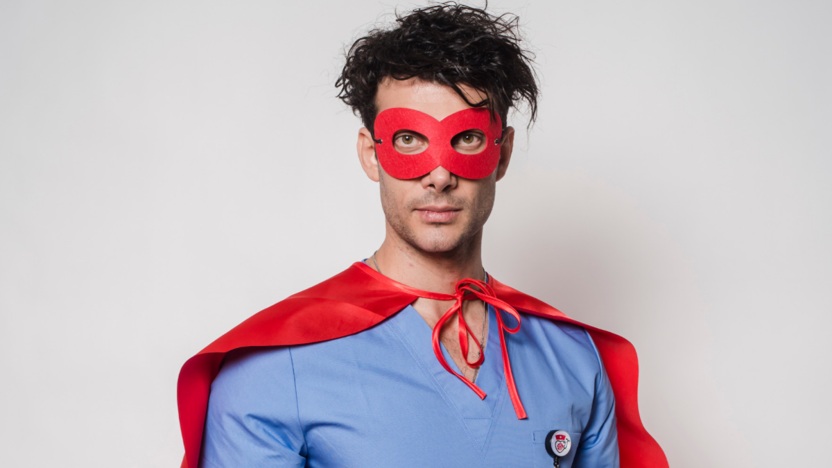 Male nurse in superhero costume halloween.