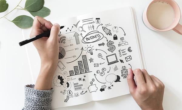 woman creating business plan