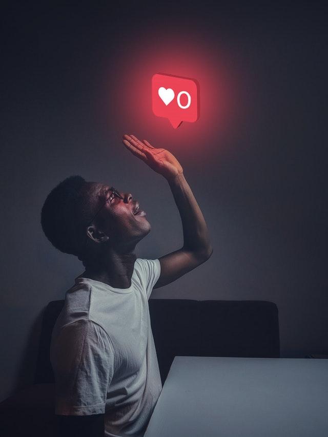 man looking at instagram like light