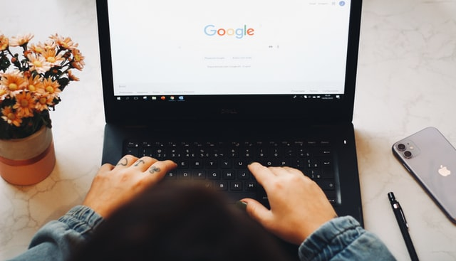 person using google on laptop