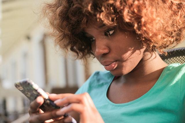 woman on smartphone using social media