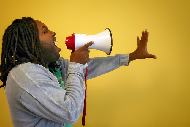 man speaking in megaphone about creating an app