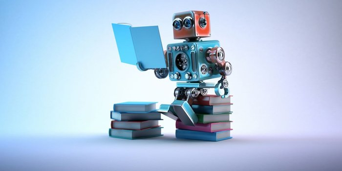 Image of robot sitting on a pile of books reading